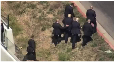 Trump escorted by Secret Service